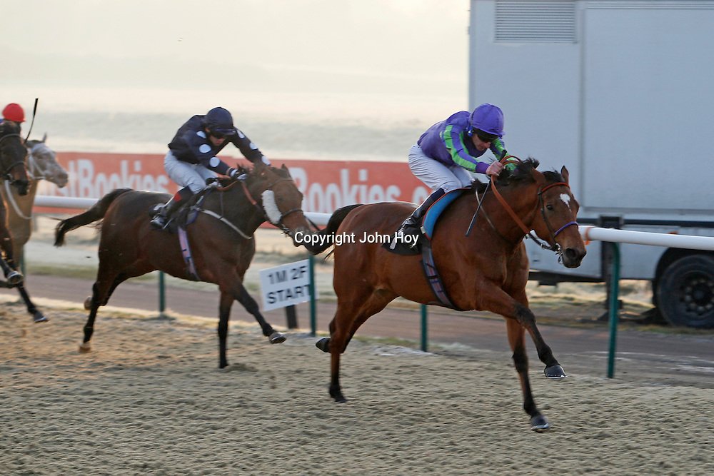 Stand Guard and Adam Kirby winning the 3.00 race