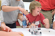 Justin Hellyer laughs with his teammates as they encounter problems assembling a battery powered car during the Russ College of Engineering and Technology research fair/engineering day in the Baker Center ballroom on Thursday, 5/3/07.