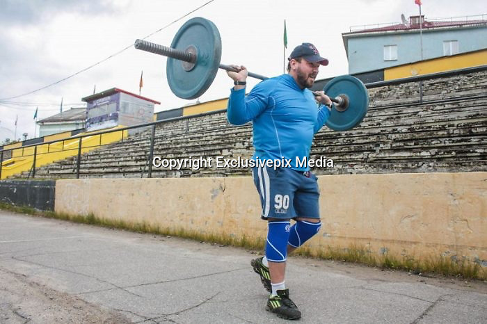 Russian bodybuilder travelled to top of Mount Elbrus with a Barbell<br /> <br /> A Russian bodybuilder has travelled to the top of the highest mountain inEurope and Russia - Mount Elbrus. He didn't travel alone. He took his favorite 75 kilo (or around 150 lbs) barbell together with him on his shoulders. It took him eight days to reach the heightof 5,642 meters (18,510 feet)! He got severely burned and was tired but still went forward and on September 6th he reached his goal. A few photos are inside.<br /> <br /> He left his barbell on top of the mountain as a live monument of his achievement.<br /> ©Exclusivepix Media