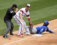 CHICAGO - JUNE 12:  Todd Frazier #21 of the Chicago White Sox tags out Christian Colon #24 of the Kansas City Royals attempting to steal third base in the second inning on June 12, 2016 at U.S. Cellular Field in Chicago, Illinois.  The Royals defeated the White Sox 3-1.  (Photo by Ron Vesely)    Subject:  Todd Frazier; Christian Colon