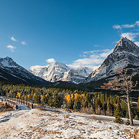 bridge and mountains in fall with snow glacier national park, swift current lake and mountain