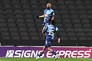 Wycombe Wanderers forward Josh Parker (27) scores a goal and celebrates  1-2 during the EFL Trophy match between Milton Keynes Dons and Wycombe Wanderers at stadium:mk, Milton Keynes, England on 12 November 2019.