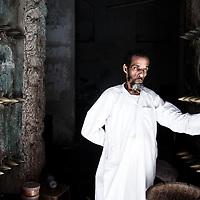 A local man stands in the doorway of his shop in Stonetown, Zanzibar