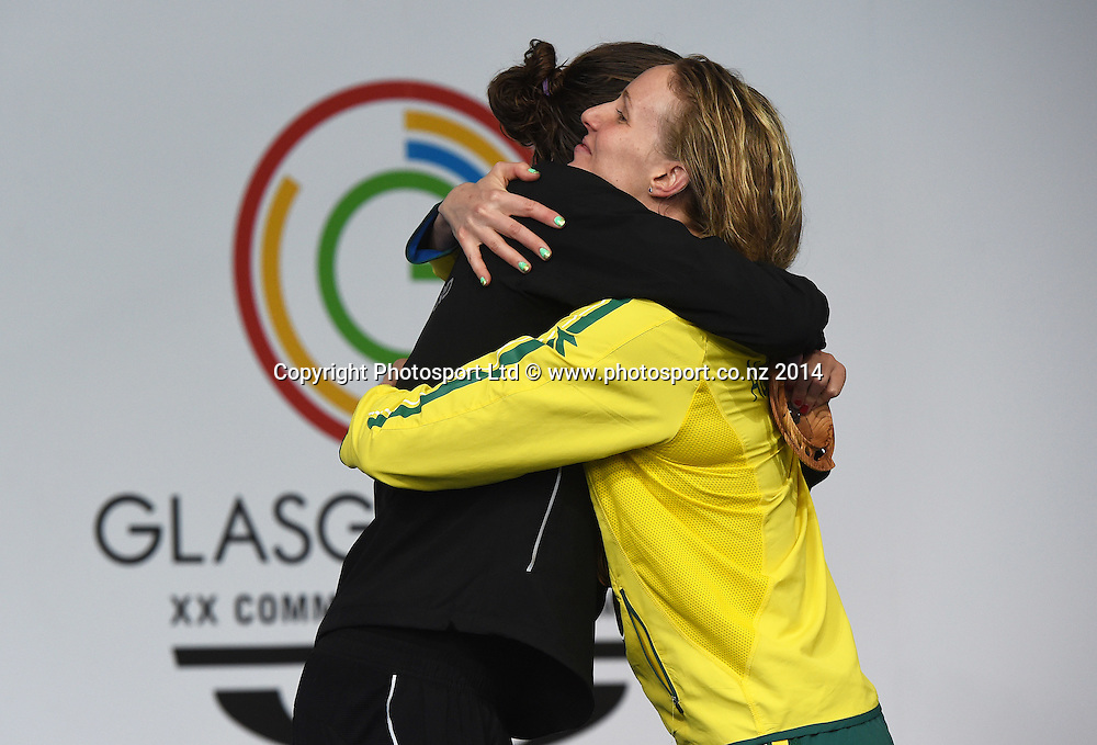 New Zealand's Lauren Boyle who won a gold medal in the Womens 400m Freestyle Final is hugged by Silver medallist Bronte Barratt. Glasgow 2014 Commonwealth Games. Swimming, The Clyde Auditorium, Glasgow, Scotland. Tuesday 29 July 2014. Photo: Andrew Cornaga / photosport.co.nz