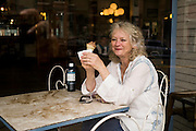 Ice Cream Parlor, a woman enjoys an ice cream cone in this historic diner.