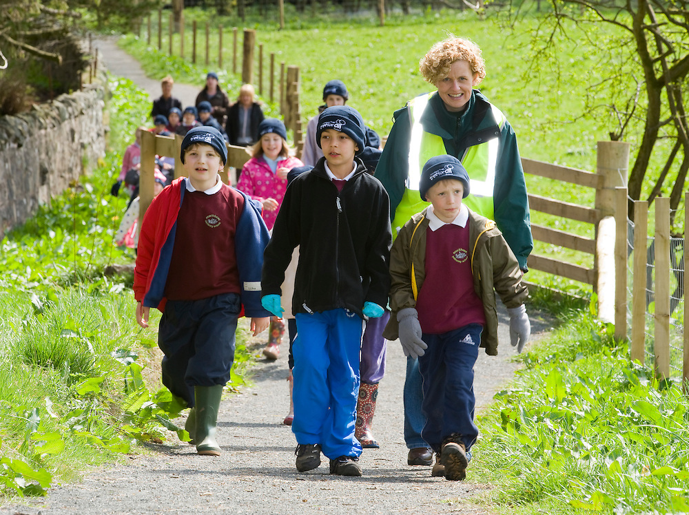 Children walking up to tree planting event at Geordie's Wood, Yetts of Muckart, Perthshire