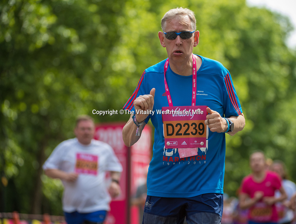 Runners two thirds of their way to completing their mile in the family waves at The Vitality Westminster Mile, Sunday 28th May 2017.<br /> <br /> Photo: Thomas Lovelock for The Vitality Westminster Mile<br /> <br /> For further information: media@londonmarathonevents.co.uk
