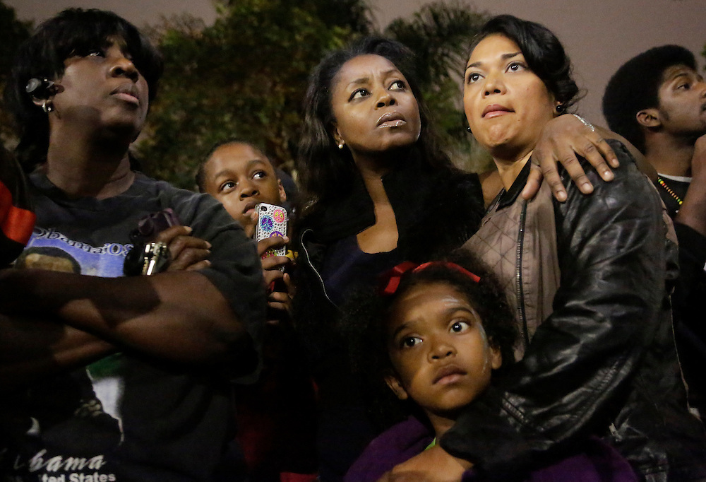 Debra Reid (L-R), Yanni Medina, 13, her mother Carol Medina, Blanca Zavala and her daughter J'Len Edmund, 6, attend a rally following the George Zimmerman verdict in the Leimert Park neighborhood of Los Angeles, California July 13, 2013. A Florida jury acquitted George Zimmerman on Saturday in the shooting death of unarmed black teenager Trayvon Martin in a case that sparked a national debate over racial profiling and self-defense laws. REUTERS/Jason Redmond   (UNITED STATES)