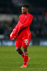 Daniel Sturridge of Liverpool looks downbeat as he removes his shirt for a fan after Liverpool win the match 0-1 - Photo mandatory by-line: Rogan Thomson/JMP - 07966 386802 - 16/03/2015 - SPORT - FOOTBALL - Swansea, Wales — Liberty Stadium - Swansea City v Liverpool - Barclays Premier League.
