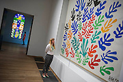 "The Sheaf and Acanthus and Nuit de Noel - stained glass. Tate Modern's new exhibition, Henri Matisse: The Cut-Outs, is devoted to the artist's paper cut-outs made between 1943 and 1954. It brings together around 120 works, many seen together for the first time, in a ""groundbreaking"" reassessment of Matisse's colourful and innovative final works. The exhibition opens at Tate Modern on 17 April 2014. They were collected together in Jazz 1947 (Pompidou, Paris), a book of 20 plates. And this will be the first time that the maquettes and the book have been shown together outside of France. Other major cut-outs in the exhibition include Tate's The Snail 1953, its sister work Memory of Oceania 1953 and Large Composition with Masks 1953. The show also includes the largest number of Matisse's Blue Nudes ever exhibited together, including the most significant of the group Blue Nude I 1952. Tate Britain, London, UK."