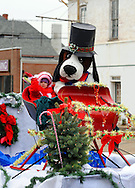 12/1/12 12:37:19 PM - Souderton, PA: .A dog mascot sits with a young girl on a float as they march on Main Street during the Souderton/Telford Holiday Parade December 1, 2012 in Souderton, Pennsylvania -- (Photo by William Thomas Cain/Cain Images)
