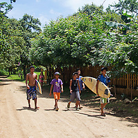 Central America, Nicaragua, Playa Remanso. Local Nicaraguan surfers head to Playa Remanso.
