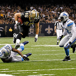 January 7, 2012; New Orleans, LA, USA; New Orleans Saints fullback Jed Collins (45) jumps over Detroit Lions cornerback Chris Houston (23) during the 2011 NFC wild card playoff game at the Mercedes-Benz Superdome. Mandatory Credit: Derick E. Hingle-US PRESSWIRE