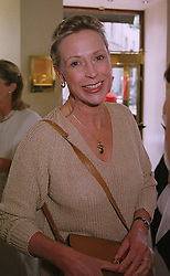 MRS EWA LEWIS former social editor of The Tatler, at a fashion show in London on 1st July 1999.MUA 26