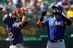 OAKLAND, CA - JULY 28:  Nomar Mazara #30 of the Texas Rangers is congratulated by Rougned Odor #12 after hitting a home run against the Oakland Athletics during the sixth inning at the RingCentral Coliseum on July 28, 2019 in Oakland, California. The Oakland Athletics defeated the Texas Rangers 6-5. (Photo by Jason O. Watson/Getty Images) *** Local Caption *** Nomar Mazara; Rougned Odor