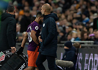 Football - 2018 / 2019 Premier League - Tottenham Hotspur vs. Manchester City<br /> <br /> Barely a glance as Sergio Aguero (Manchester City) walks past Pep Guardiola, Manager of Manchester City, after being substituted at Wembley Stadium.<br /> <br /> COLORSPORT/DANIEL BEARHAM