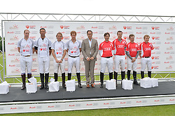 Left to right, HRH THE DUKE OF CAMBRIDGE, JOHN PAUL CLARKIN, MARK TOMLINSON, HRH PRINCE HARRY, ANDRE KONSBRUCK Director of Audi UK, MICHAEL BICKFORD, JAMES HARPER, JAMES BEIM and JAMES MESQUITA at the Audi Polo Challenge at Coworth Park, Blacknest Road, Ascot, Berkshire on 31st May 2015.