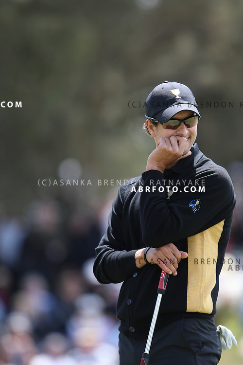 20 November 2011 : International Adam Scott hides his frustration after missing a putt during the fifth-round Sunday Final round single ball matches at the Presidents Cup at the Royal Melbourne Golf Club in Melbourne, Australia. .