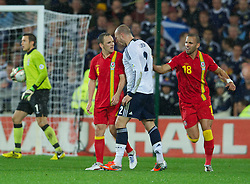 CARDIFF, WALES - Friday, October 12, 2012: Wales' David Vaughan squares up to Scotland's Alan Hutton during the Brazil 2014 FIFA World Cup Qualifying Group A match at the Cardiff City Stadium. (Pic by David Rawcliffe/Propaganda)
