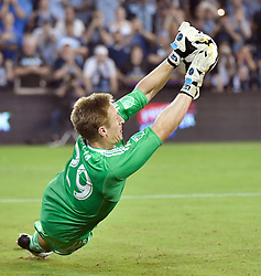 Sporting Kansas City goalkeeper Tim Melia blocks the final penalty kick for the win against the San Jose Earthquakes during the U.S. Open Cup semifinals at Children's Mercy Park in Kansas City, Kan., on Wednesday, Aug. 9, 2017. Sporting KC advanced on penalty kicks, 5-4, after the teams tied, 1-1, in regulation. (Photo by John Sleezer/Kansas City Star/TNS/Sipa USA) *** Please Use Credit from Credit Field ***