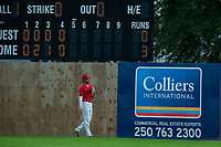 KELOWNA, BC - JULY 06: Brandon Hupe #18 of the Kelowna Falcons stands at centre field after a ball went over the fence by the Walla Walla Sweets at Elks Stadium on July 6, 2019 in Kelowna, Canada. (Photo by Marissa Baecker/Shoot the Breeze)