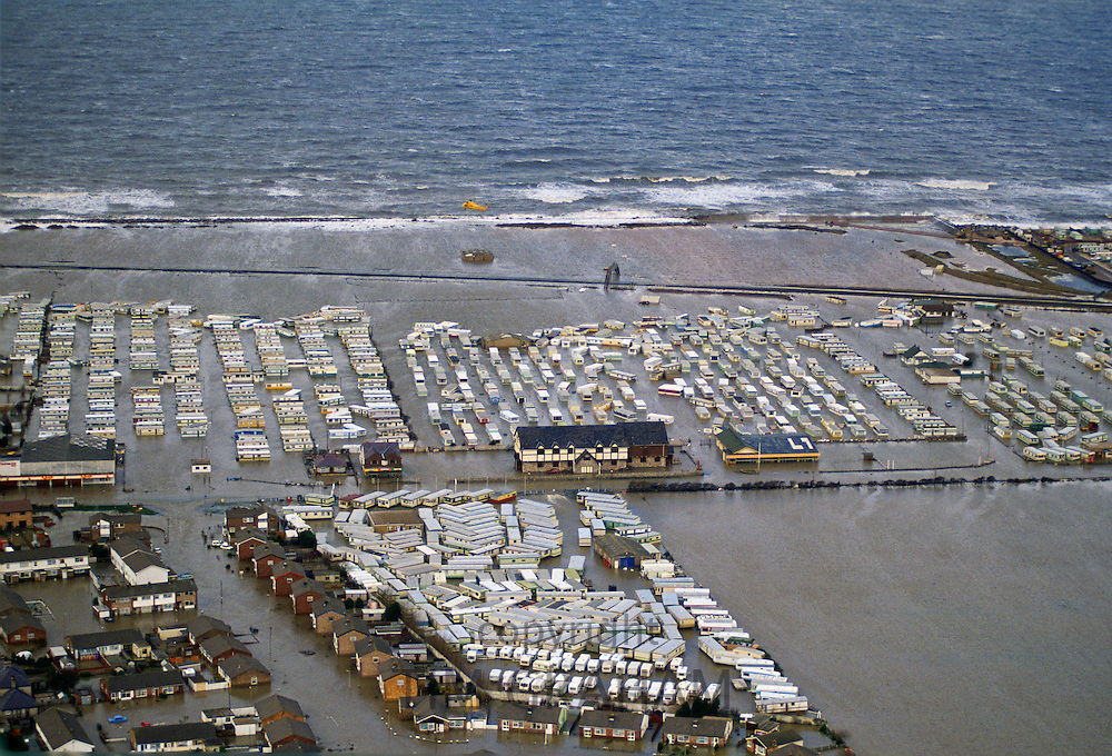 Houses and caravans in the flooded town of Towyn in North Wales, United Kingdom.