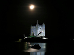 A floodlit Castle Stalker on the shores of Loch Linnhe bathed in winter moonlight. The castle is visible from the road midway between Oban and Glen Coe. The castle was also used as a  location for the filming of Monty Python and the Holy Grail...... (c) Stephen Lawson   Edinburgh Elite media