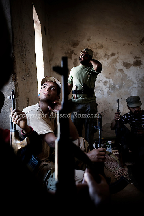 LIBYAN ARAB JAMAHIRIYA, Gualish : Libyan rebels gather at the front line on the eastern ridge of the Nafusah Mountains in Western Libya, on the outskirt of Gualish, on July 11, 2011 .ALESSIO ROMENZI