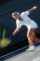 Young woman hitting a tennis ball&#xA;<br />