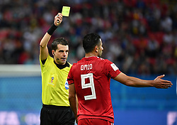 KAZAN, June 20, 2018  Omid Ebrahimi (R) of Iran is given a yellow card during a Group B match between Spain and Iran at the 2018 FIFA World Cup in Kazan, Russia, June 20, 2018. Spain won 1-0. (Credit Image: © Liu Dawei/Xinhua via ZUMA Wire)