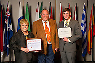 Pryor native Bryce Hauenstein (right), an agricultural education major, receives an Oklahoma State University Win and Kay Ingersoll Scholarship from Win and Kay Ingersoll (left) at the university's recent College of Agricultural Sciences and Natural Resources Scholarships and Awards Banquet. The scholarship is part of more than $1.4 million in scholarships and awards presented to CASNR students for the 2016-2017 academic year. (Photo by Todd Johnson)