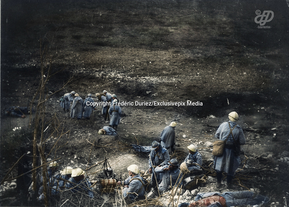 """Colorized photographs soldiers from the World War One<br /> <br /> With his impressive colorized photographs of the World War One, Frédéric Duriez gives us a new look at the conflict that ravaged the world between 1914 and 1918, revealing the difficult daily life of the French soldiers. <br /> <br /> Photo Shows: """"Region of Verdun - 1916<br /> After the fighting, soldiers surrounded the bodies of their comrades.<br /> ©Frédéric Duriez/Exclusivepix Media"""