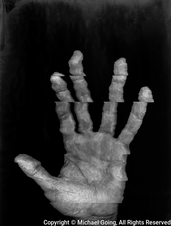 Man's right hand, palm view in black and white, compositing made obvious