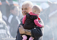 Warwick, New York  A man carries a baby duringthe Applefest  harvest celebration on Oct. 3, 2010.