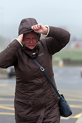 © Licensed to London News Pictures. 8/02/2016. Porthcawl, Bridgend, Wales, UK. A womanbattles against the powerful wind on the seafront. People struggle to stay on their feet in winds gusting over approximately 60mph. Storm Imogen batters the small Welsh seaside resort of Porthcawl in the county borough of Bridgend on the South coast of Wales, UK. Photo credit: Graham M. Lawrence/LNP