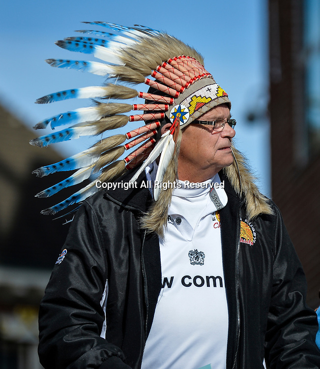 22.03.2015.  Northampton, England. LV Cup Final. Saracens versus Exeter Chiefs. An exeter fan arrives in full native indian headgear.