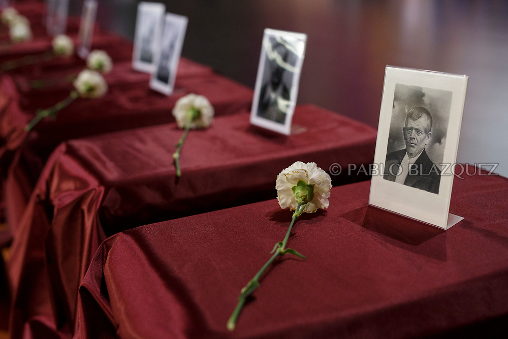 19/05/2018. A picture depicting Victorino Diaz de Randa stands on top of a box containing his remains during a ceremony to hand the remains of 22 people assassinated by dictator Francisco Franco's forces to their relatives on May 19, 2018 in Guadalajara, Spain. General Franco's forces killed Timoteo Mendieta and other people between 1939 and 1940 after Spain's Civil War and buried them in mass graves in Guadalajara's cemetery. Argentinian judge Maria Servini used the international human rights law and ordered the exhumation and investigation of Mendieta's mass grave. The exhumation was carried out by Association for the Recovery of Historical Memory (ARMH) recovering 50 bodies from 2 mass graves and identified 24 of them. Spain's Civil War took the lives of thousands of people on both sides, but Franco continued his executions after the war has finished. Spanish governments has never done anything to help the victims of the Civil War and Franco's dictatorship while there are still thousands of people missing in mass graves around the country. (© Pablo Blazquez)