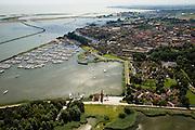 Nederland, Noord-Holland, Enkhuizen, 14-07-2008; in de voorgrond het Zuiderzeemuseum (Buitenmuseum) en jachthaven; op het tweede plan de historische binnenstad; in de achtergrond het Markermeer en het begin van de dijk naar Almere (Houtribdijk) . .luchtfoto (toeslag); aerial photo (additional fee required); .foto Siebe Swart / photo Siebe Swart