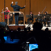 """June 8, 2012 - New York, NY : David Robertson, standing at center left, conducts the New York Philharmonic in Pierre Boulez's """"...explosante-fixe..."""" (1991-93), with computer music design, production, and sound engineering by IRCAM, during The Metropolitan Museum of Art's Presentation of """"CONTACT!,"""" the new-music series of the New York Philharmonic, on Friday night. The piece featured Robert Langevin on MIDI-flute (wearing red). CREDIT: Karsten Moran for The New York Times"""