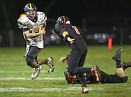 Midland's Ryan Leonard (7) is tripped up by Springville's Elias Nissen (40) as Brian Allsup (1) closes in during their game at Allison Field in Springville on Friday October 19, 2012. Midland defeated Springville 30-29.