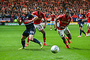 Doncaster Rovers midfielder Tommy Rowe (10), Charlton Athletic midfielder Joe Aribo (17) and Charlton Athletic defender Anfernee Dijksteel (2) chase the ball during the EFL Sky Bet League 1 second leg Play-Off match between Charlton Athletic and Doncaster Rovers at The Valley, London, England on 17 May 2019.
