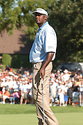 Jul 30, 2005; Grand Blanc, MI, USA; Vijay Singh who finished play Saturday at 22 under par shoots a glance at a loud fan in the bleachers aroung the eighteenth green at the 2005 Buick Open, Warwick Hills Golf & Country Club. Copyright © 2005 Kevin Johnston