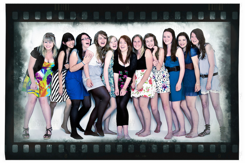 Full length studio portrait photograph, in Bristol, by Jonathan Bowcott of 11 female friends. Shot in colour, with a desaturated grungy feel and used with a 35mm border