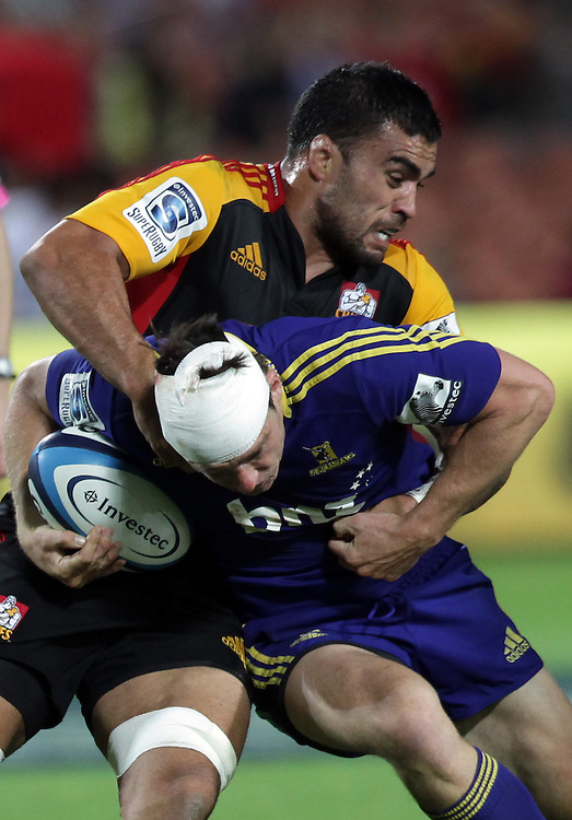 Chiefs' Liam Messam tackles Highlanders' Ben Smith in a Super Rugby match, Waikato Stadium, Hamilton, New Zealand, Friday, March 22, 2013.  Credit:SNPA / David Rowland