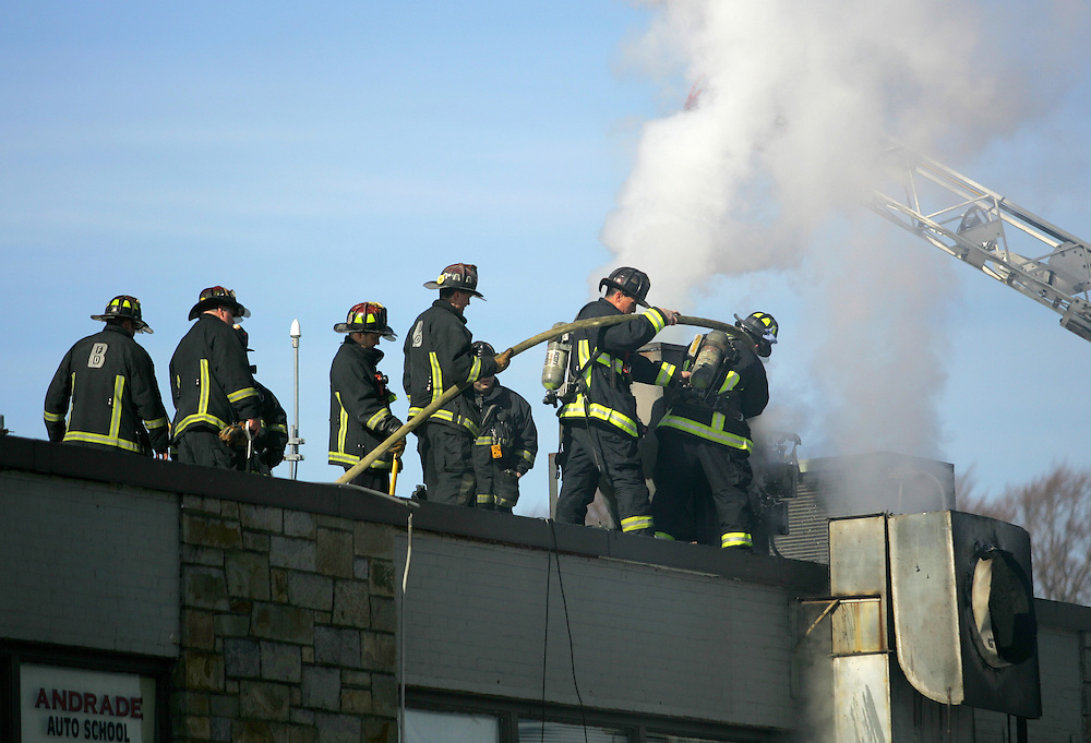 Boston, MA 02/11/2011.Boston Firefighters extinguish a 2 alarm fire in the ventilation system at China Sky restaurant on Gallivan Blvd. in Dorchester on Friday afternoon..Alex Jones / www.alexjonesphoto.com