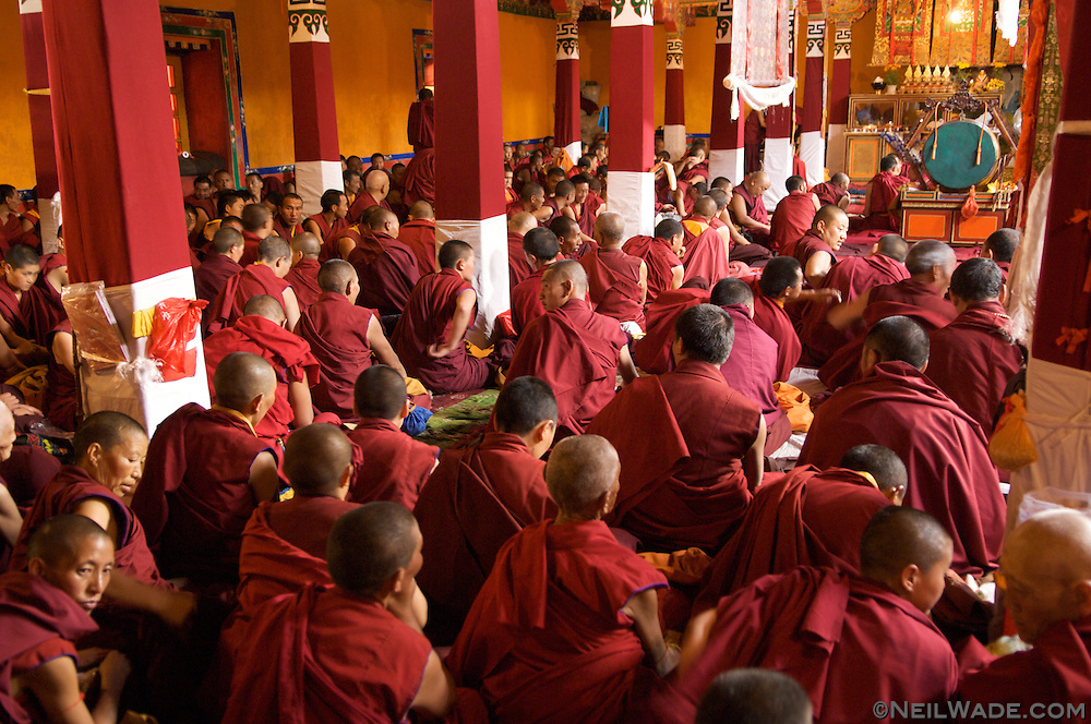 Tibetan monks and nuns gather for a chanting session in the Jokhang in Lhasa, Tibet.