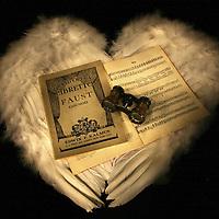Angel wings,music score and binoculars