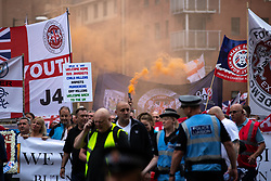 © Licensed to London News Pictures . 02/06/2018. Manchester, UK. Approximately 1,000 DFLA supporters march through Manchester City Centre . The Democratic Football Lads Alliance demonstrate in Manchester , eleven days after the first anniversary of the Manchester Arena terror attack . Photo credit : Joel Goodman/LNP