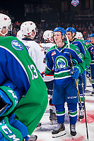 REGINA, SK - MAY 23: Aleksi Heponiemi #20 of the Swift Current Broncos shakes hands with the Regina Pats at the Brandt Centre on May 23, 2018 in Regina, Canada. (Photo by Marissa Baecker/CHL Images)