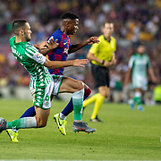 BARCELONA, SPAIN - August 25:  Anssumane Fati #31 of Barcelona is tackled by Alfonso Pedraza #6 of Real Betis during the Barcelona V  Real Betis, La Liga regular season match at  Estadio Camp Nou on August 25th 2019 in Barcelona, Spain. (Photo by Tim Clayton/Corbis via Getty Images)